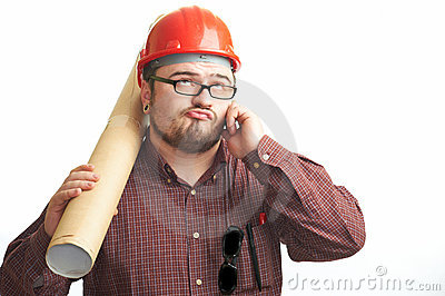Serious builder in glasses and red hard hat