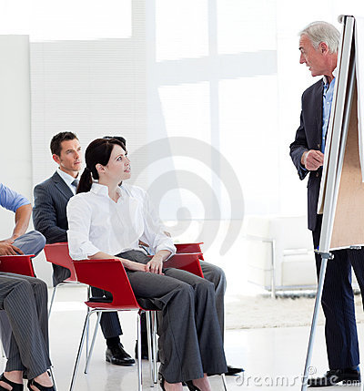 Free Serious Business People At A Conference Stock Photos - 12118943