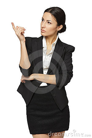 Serious business woman pointing at copy space