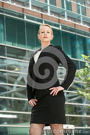 Serious business woman standing outside the office