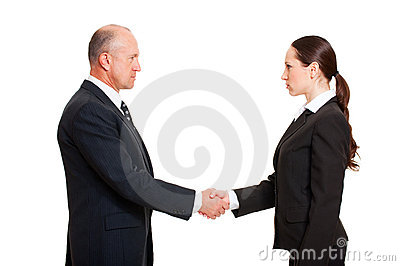 Serious businessman greeting young woman