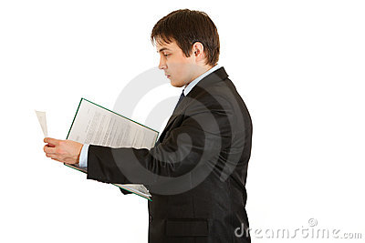 Serious businessman holding folder with documents