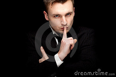 Serious businessman keeping silence