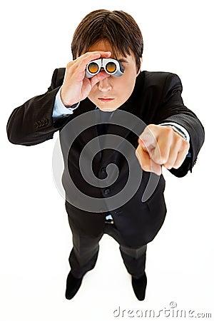 Serious businessman looking through binoculars