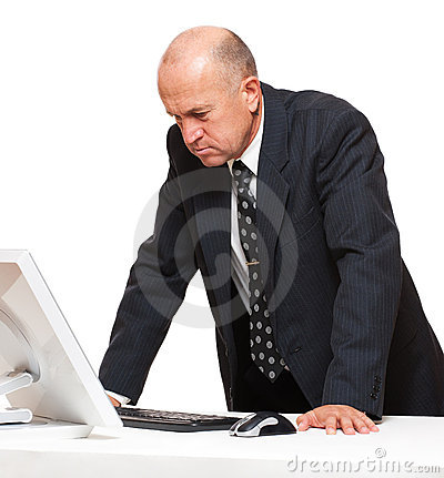 Serious businessman looking at monitor