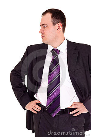 Serious businessman looks somewhere