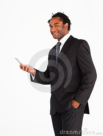 Serious businessman sending text message
