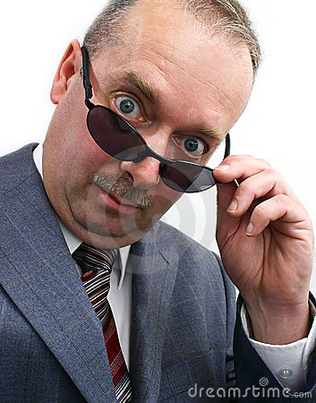 Free Serious Businessman Takes Sunglasses Off Royalty Free Stock Photos - 881458