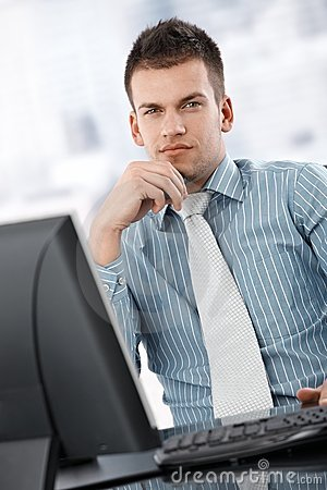 Serious businessman thinking at desk