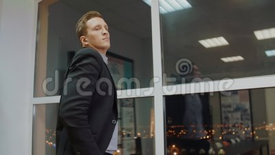 Serious businessman thinking about solve of business problem in evening office. Late night. Pensive boss man thinking new business project. Business people stock footage
