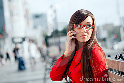 Serious businesswoman  calling by phone