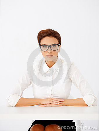 Serious businesswoman in glasses