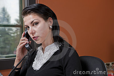 Serious Businesswoman On The Phone