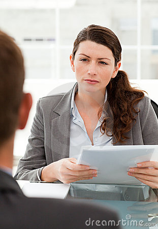 Serious businesswoman questionning a man