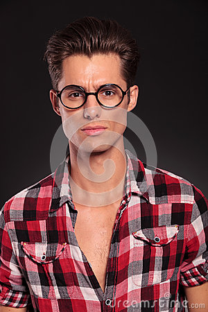 Serious casual man wearing glasses