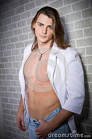 Serious caucasian man portrait in white jacket