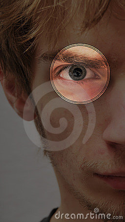 Serious determined young man eye scan