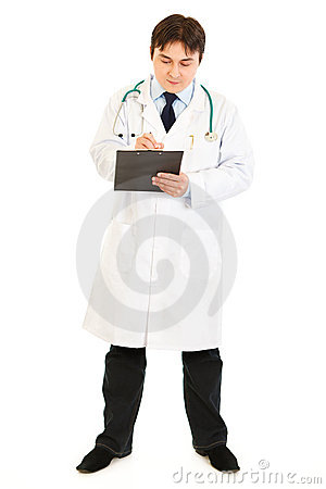 Serious doctor making notes in medical chart