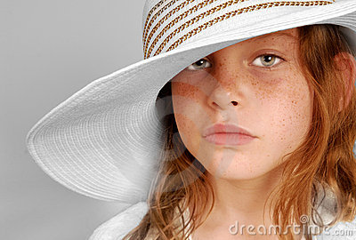 Serious girl in hat