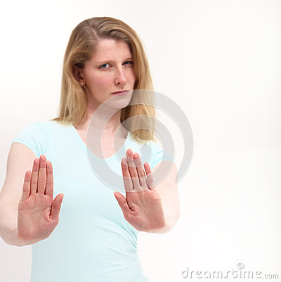 Free Serious Girl Holding Out Her Hand Signaling Stop Stock Photo - 24632740
