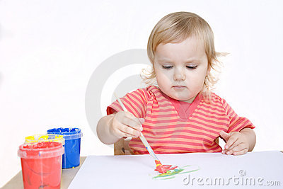 Serious girl painting with brush