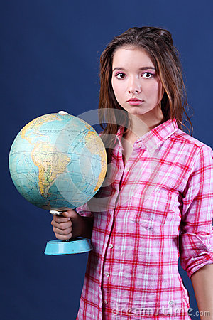 Serious girl in plaid shirt holds Globe.