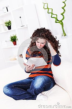 Serious girl reading