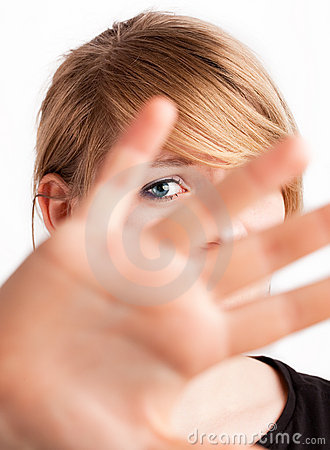 Serious girl showing negation. isolated on white b