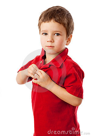Serious little boy in red shirt