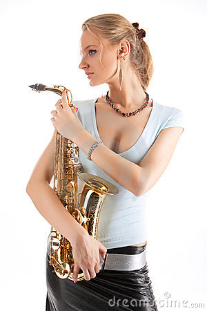 Serious look blonde girl with saxophone