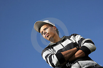 Serious looking teenager with baseball cap