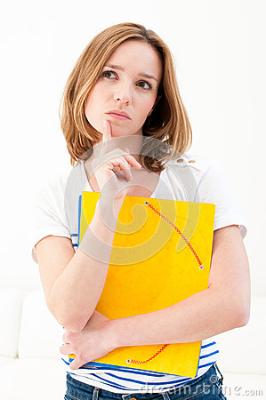 Serious looking woman with folders