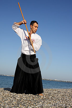 Serious man exercising aikido