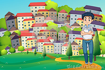 A serious man standing at the hilltop across the village