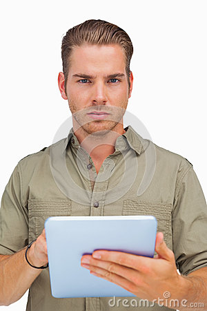 Serious man using tablet pc