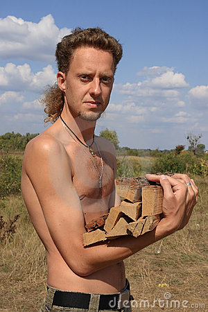 Free Serious Man With Woodpile Royalty Free Stock Photos - 12400548