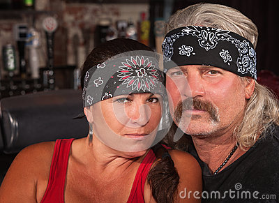 Serious Middle Aged Couple in Bar