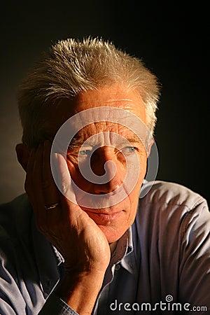 Serious older man looking away