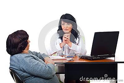 Serious physician listen her patient problems