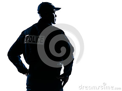 Serious policeman with looking to his side