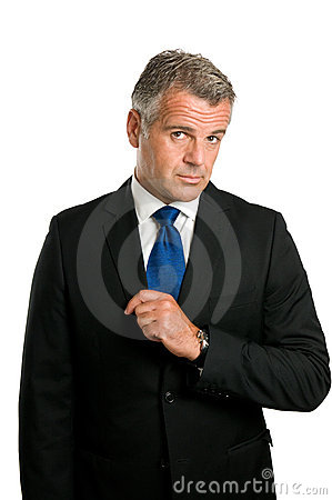 Serious and puzzled mature businessman