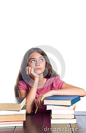 Serious schoolgirl looking up