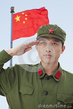 Free Serious Soldier Saluting China S Flag Royalty Free Stock Image - 31108626