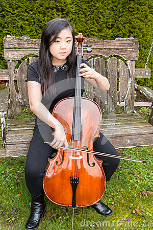 Serious Teen Playing Cello Outside