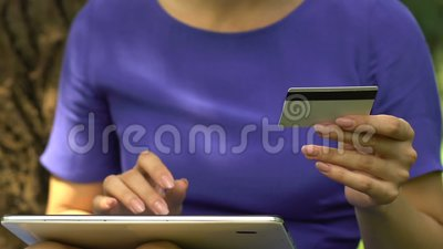 Serious woman entering card number on tab, instant money transfer, finance app. Stock footage stock footage