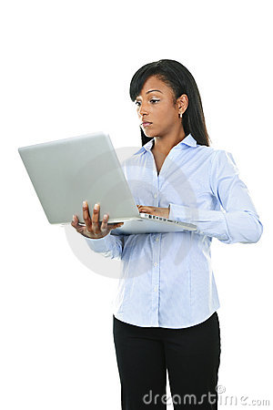 Serious woman with laptop computer