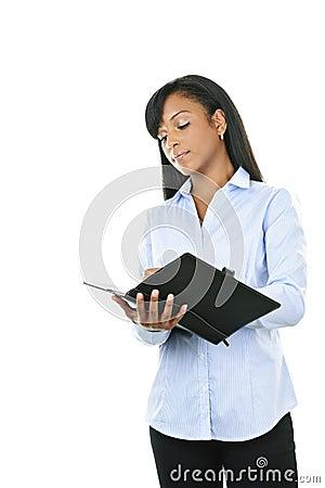 Serious woman with leather portfolio folder