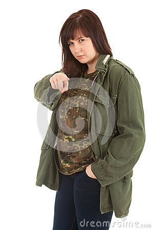 Serious woman in military jacket pointing you
