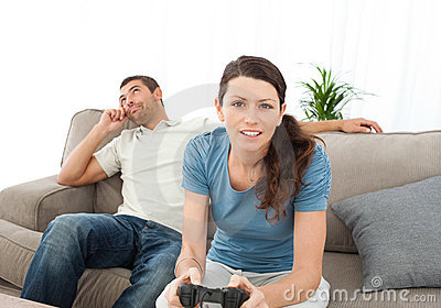 Serious woman playing video game