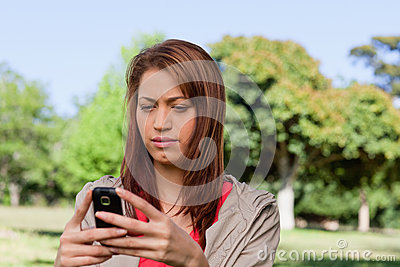 Serious woman reading a text message